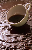 Cup in a whirlwind of coffee Stock Photos