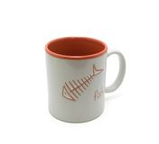 Cup on white background. Cup with picture of the skeleton fish Royalty Free Stock Photography