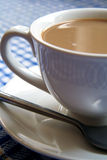Cup of white coffee. Picture a cup of white coffee on a table Stock Photo