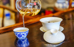A cup of whole leaf lapsang souchong tea, a rich smoky flavored tea Stock Image