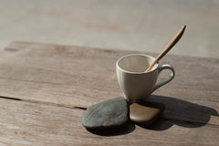 Cup wih tea spoon on stone background Stock Photo