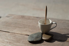 Cup wih tea spoon on stone background Stock Photography