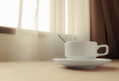 Cup by the window Royalty Free Stock Photography