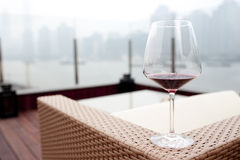 Cup of wine in front of  huangpu river Royalty Free Stock Image