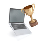Cup winner and laptop  on white background. Golden cup winner and laptop  on white background, 3D rendering Stock Photography