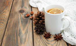 Cup of winter tea. With scarf on a wooden background Royalty Free Stock Images