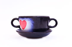 Cup wit heart Stock Photos