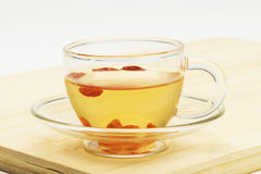 Cup of wolfberry tea Royalty Free Stock Photos