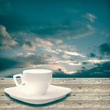 Cup  on wood Stock Images