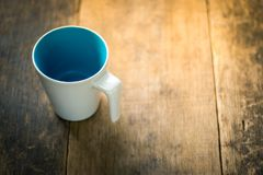 Cup on wood table Royalty Free Stock Photos