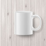 Cup on wooden backdrop Stock Images