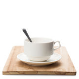 Cup on wooden plate Isolated on white background Royalty Free Stock Photography