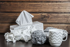 Cup, wool cap and tissues. For winter Stock Photography