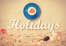 Cup and word Holidays Royalty Free Stock Photos