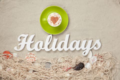 Cup and word Holidays Stock Image