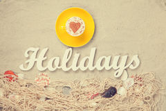 Cup and word Holidays Royalty Free Stock Photo