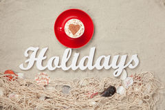 Cup and word Holidays Royalty Free Stock Image