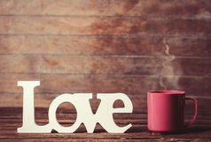 Cup and word Love Royalty Free Stock Image