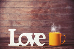 Cup and word Love Royalty Free Stock Images