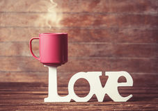 Cup and word Love Stock Image