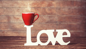 Cup and word Love Royalty Free Stock Photos