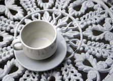Cup on wrought iron garden table Royalty Free Stock Photo