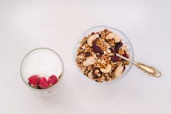 Cup of yogurt and granola bowl. Healthy breakfast. Top view.  Stock Photo