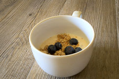 Cup of yougurt with blueberries. With a vitae food Stock Image