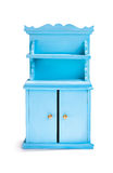 Cupboard. Miniature blue cupboard on white background stock images