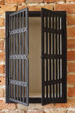 Cupboard on a brick wall Stock Photo
