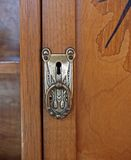 Cupboard Door Handle. Wooden cupboard with antique design handle Royalty Free Stock Images