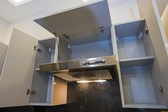 Cupboard with extractor fan in modern apartment kitchen royalty free stock photography