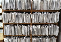 A cupboard full of paper files. / inefficiency of paper based filing system Stock Images