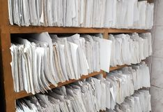 A cupboard full of paper files. / inefficiency of paper based filing system Royalty Free Stock Photography