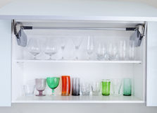 Cupboard with glasses Stock Images
