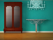 Cupboard with metallic table and glass chandelier Royalty Free Stock Photography