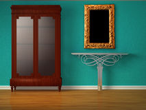 Cupboard with metallic table and mirror Royalty Free Stock Images