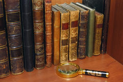 Cupboard with old books stock photography
