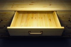 Cupboard with opened drawer Royalty Free Stock Image