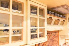 Cupboard in rustic kitchen Royalty Free Stock Photo