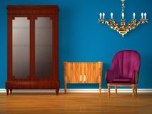 Cupboard with table, golden chandelier and chair Stock Photography
