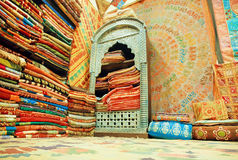 Cupboard of traditional Indian souvenir shop, full of silk shawls and scarves Royalty Free Stock Images