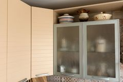 Cupboards in the kitchen Stock Images