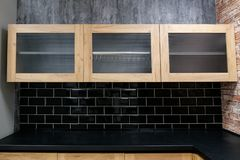 Cupboards with transparent front panels and wooden borders