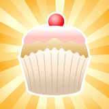 Cupcacke on sunburst background Royalty Free Stock Photos
