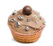 Cupcake με την τήξη σοκολάτας και διακόσμηση στο άσπρο κλίμα Στοκ Εικόνες