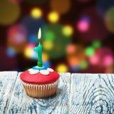Cupcake με τον αριθμό ένας στο υπόβαθρο Στοκ Εικόνα