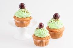 Cupcake με το κεράσι Στοκ Εικόνες
