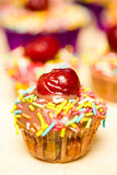Cupcake. Sweet colored cupcake with cherry stock photography
