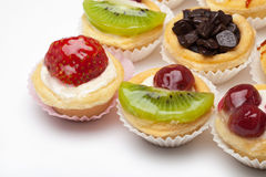 Cupcake. Strawberry, cherry, kiwi, and chocolate cupcake royalty free stock image